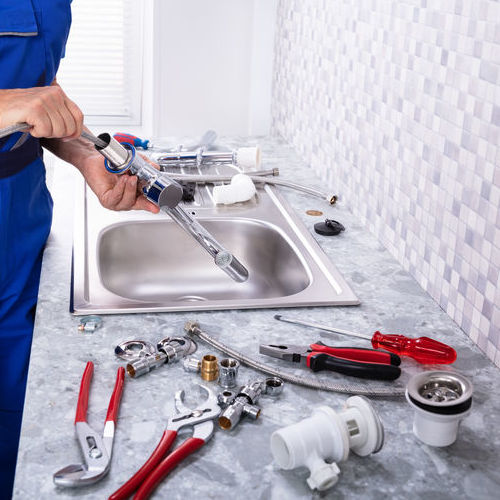 An Assembly of Plumbing Tools Laid On Counter