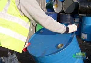 Man moves a recycling drum