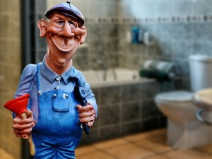 a photo of a plumber figurine holding a plunger